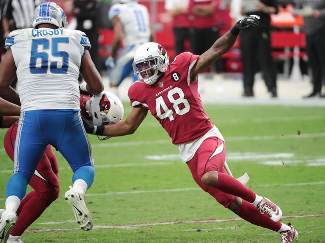 Arizona Cardinals linebacker Isaiah Simmons (48) rushes against Detroit Lions offensive tackle Tyrell Crosby (65) during the third quarter at State Farm Stadium Sept. 27, 2020.