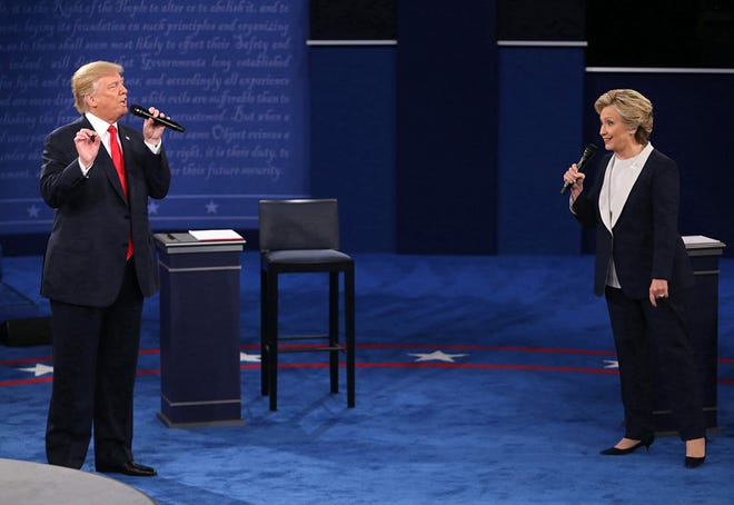 In this file image from the 2016 debates Donald Trump and and Hillary Clinton on stage during the second debate between the Republican and Democratic presidential candidates on October 9, 2016, at Washington University in St. Louis. (Christian Gooden/St. Louis Post-Dispatch/TNS)