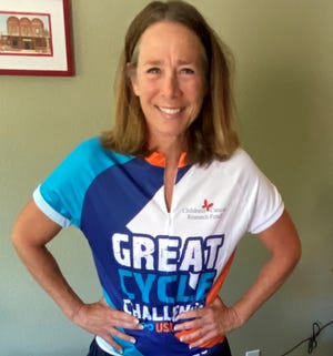 Mendive vice-principal Trish Carroll is riding her bike to raise money for pediatric cancer research.