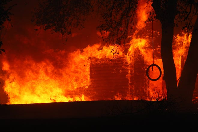 A house along Ono Road burns down Sunday, Sept. 27, 2020 in the Zogg Fire.