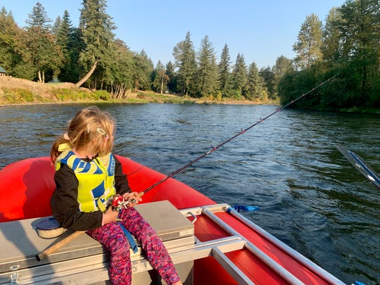 Lucy Urness, 5, fishes from a raft on the North Santiam River between Fishermen's Bend Recreation Site and Mehama-Lyons boat ramp on Sept. 5.