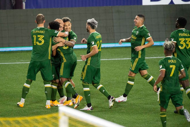 Portland Timbers forward Felipe Mora (9) celebrates with teammates after scoring a goal during the first half against the Vancouver Whitecaps at Providence Park.