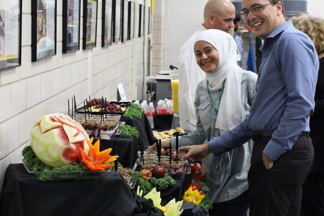 Joshua Bain catering with nutritionist Enas Maki.