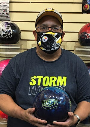Brian Collins, donning a Pittsburg Steelers mask, began the 2020-21 season in Early RIsers League play with a 648 series on games of  257, 234 and 157.