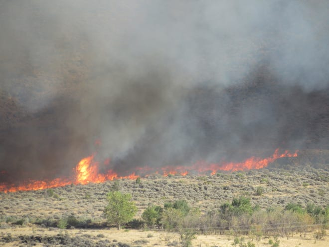 Fire and smoke erupted late Sunday over the Veyo Volcano north of Dammeron Valley after a wildfire started along the nearby state Route 18 highway. The blaze headed south and west toward Sand Cove Reservoir.