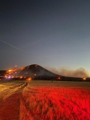 A wildfire burned over the cinder cone known as the Veyo Volcano south of Dammeron Valley late Sunday.