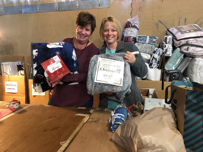 Patti McMullen and Amy Goldsberry coordinating blanket drive for last's years Christmas Connection, which is seeking a location for this year's collection drive.