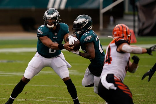 Philadelphia Eagles' Jalen Hurts (2) hands off to Miles Sanders (26) during the second half of an NFL football game against the Cincinnati Bengals, Sunday, Sept. 27, 2020, in Philadelphia. (AP Photo/Chris Szagola)