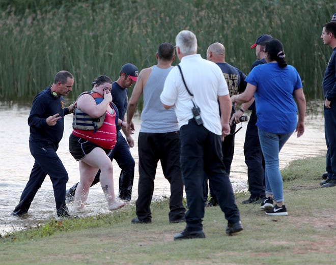 The Wichita Falls Fire Department rushed out to Lake Wichita Sunday, Sept. 27, 2020, to rescue Tammy Williams and her two daughters Ashley Hill and Brittany Hill, who were caught in the water after strong winds stirred up the waves and pushed them off their paddle boards.