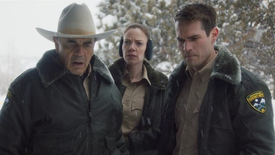 """Sheriff Hadley (Robert Forster, left) investigates a vicious murder with fellow officers Julia (Riki Lindhome) and his son John (Jim Cummings) in """"The Wolf of Snow Hollow."""""""