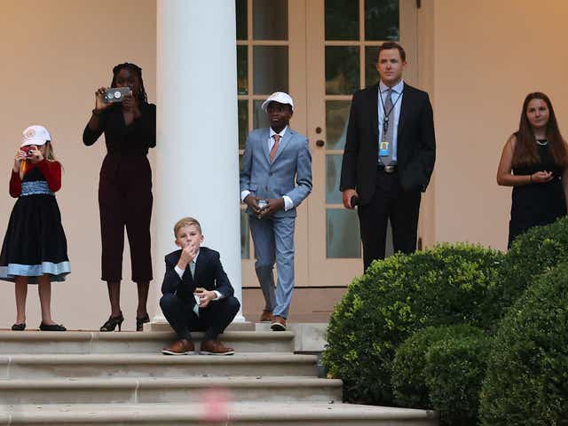 Six of 7th U.S. Circuit Court Judge Amy Coney Barrett's seven children stand the Rose Garden Colonnade as they watch U.S. President Donald Trump's helicopter leave the White House from Sept. 26, 2020 in Washington, DC. Trump announce Barrett as his nominee for the Supreme Court. With 38 days until the election, Trump tapped Barrett to be his third Supreme Court nominee in just four years and to replace the late Associate Justice Ruth Bader Ginsburg, who will be buried at Arlington National Cemetery on Tuesday.