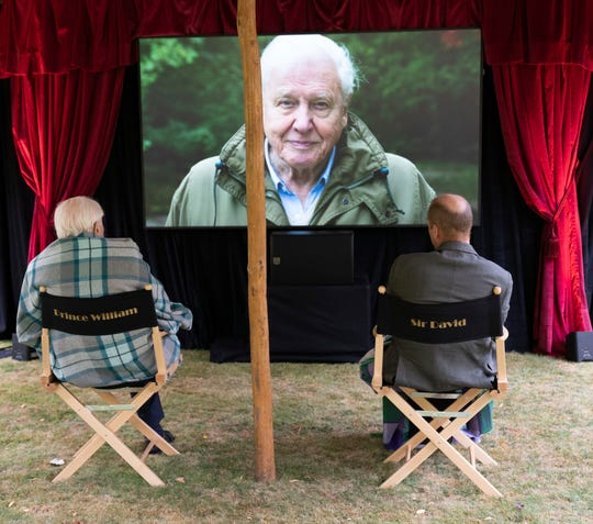 British nature filmmaker Sir David Attenborough gave Prince William a private screening of his latest film in the garden of Kensington Palace, in a photo released on September 26, 2020.
