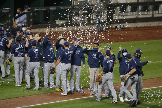 The Tampa Bay Rays celebrate clinching the American League East division title with confetti cannons after defeating the New York Mets at Citi Field.