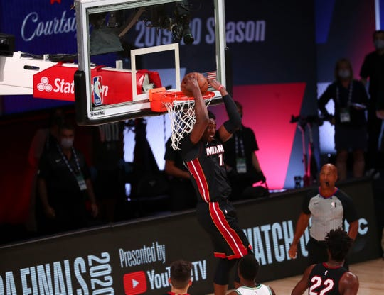 SMiami Heat forward Bam Adebayo (13) dunks the ball backwards against the Boston Celtics during the fourth quarter in game six of the Eastern Conference Finals of the 2020 NBA Playoffs at AdventHealth Arena. Mandatory Credit: Kim Klement-USA TODAY Sports