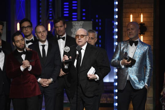"""The Boys in the Band"" playwright Mart Crowley accepts the Tony Award for best revival of a play, along with producer Ryan Murphy, right, and cast members in 2019."