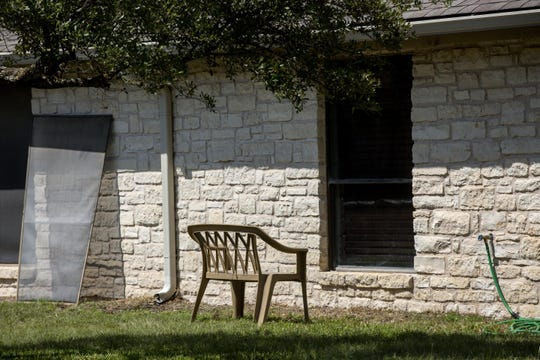 A chair is placed next to a window at Pflugerville Health Care Center for visitors kept outside by coronavirus precautions. Many family members are eager to resume in-person visits with their loved ones.