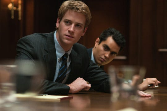 Tyler and Cameron Winklevoss (Armie Hammer) and Divya Narendra (Max Minghella) sue Mark Zuckerberg (Jesse Eisenberg) for theft of intellectual property.