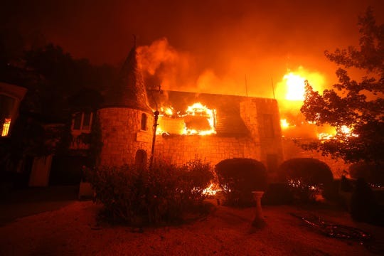 ST.  HELENA, CALIFORNIA - SEPTEMBER 27: Chateau Boswell Wine Cellar burns while the Glass Fire moves through the area on September 27, 2020 in St. Helena, California.  The fast-moving glass fire burned more than 1,500 acres and destroyed homes.  Much of Northern California is under a red flag warning of high fire risk until Monday night.  (Photo by Justin Sullivan / Getty Images) *** BESTPIX *** ORG XMIT: 775568437 IDENTIFICATION OF ORIGIN: 1277061462