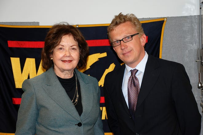 Jane Snider of Akron stands with David Schwake, political counselor, Embassy of the Federal Republic of Germany, in Washington, D.C., for a 2009 WZIP radio interview.