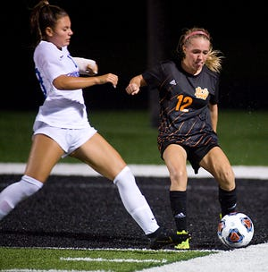 Marlington's Mykah Kackley, right, shown in a game earlier this season, scored two goals in the Dukes' win over Alliance.