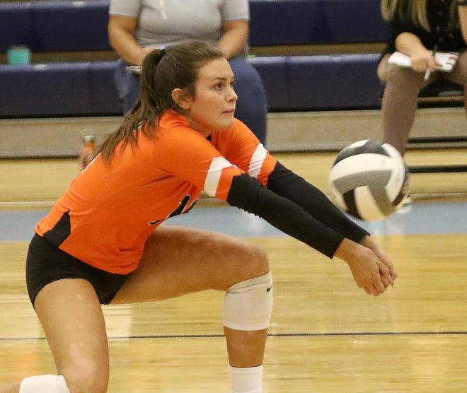 Marlington's Lauren Graffice returns a Louisville serve during volleyball action at Louisville High School Monday, September 28, 2020.