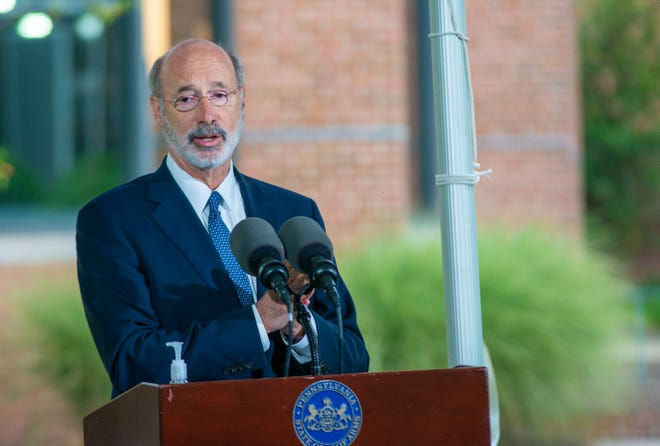 Gov. Tom Wolf makes remarks during a news conference addressing affordable health care Tuesday in Doylestown.