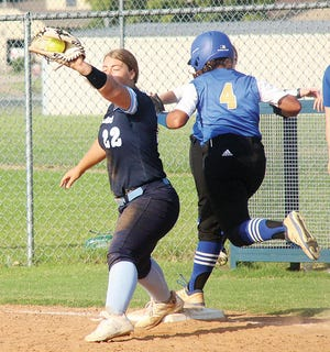 Bartlesville High first baseman Sydney Price, left, spears the ball in time for an out during softball action.