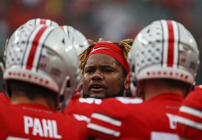 Ohio State Buckeyes offensive lineman Wyatt Davis (52) fires up his teammates before a NCAA Division I college football game between the Ohio State Buckeyes and the Wisconsin Badgers on Saturday, October 26, 2019 at Ohio Stadium in Columbus, Ohio. [Joshua A. Bickel/Dispatch]
