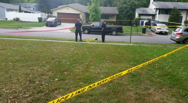 Columbus police investigate the scene where a teenage boy was fatally shot at Heartherton and Sharbot drives at Northtowne Park on the Northeast Side.