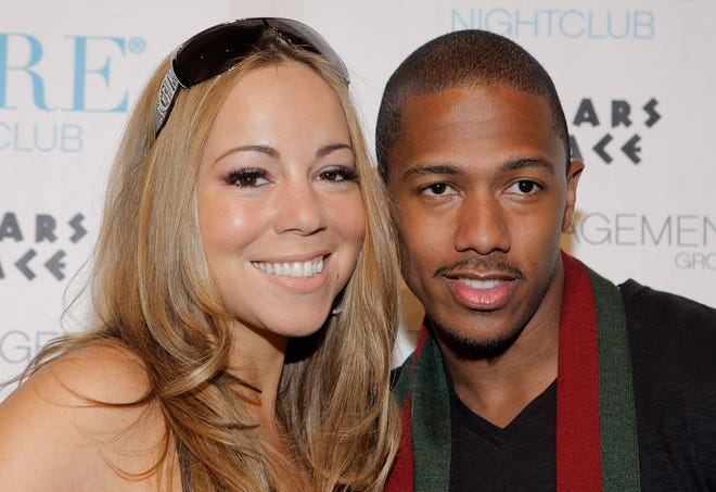 In her new memoir, Mariah Carey writes about how she and her second husband, comedian and rapper Nick Cannon, pictured in 2008, divorced when their children were small.