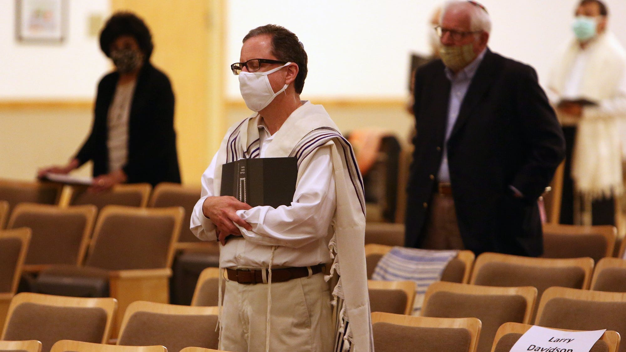 Larry Davidson is among the few people allowed in the sanctuary in assigned seatsfor the Yom Kippur service at Congregation Agudas Achim on Monday night. As part of the pandemic response, the service was livestreamed. [ERIC ALBRECHT/Dispatch]