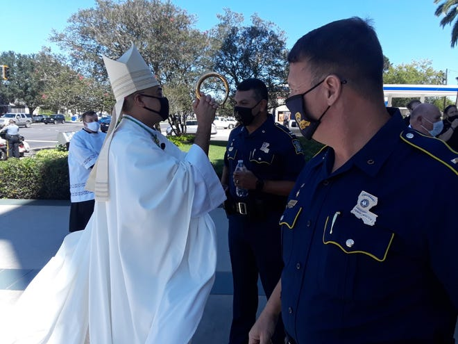 Local Bishop Shelton Fabre  greets police after Tuesday's Blue Mass at St. Joseph Co-Cathedral in Thibodaux.