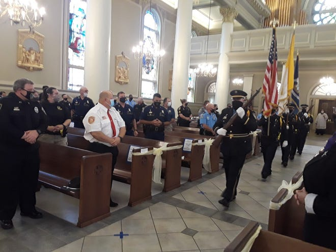 An honor guard leads the procession to begin Tuesday's Blue Mass in Thibodaux to honor first responders.