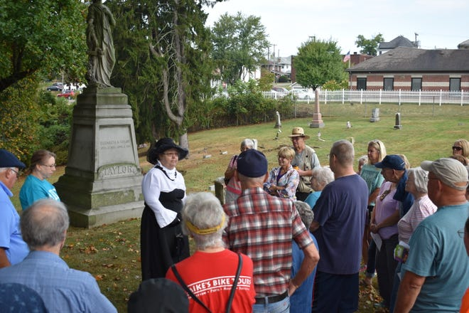 During the Coming Alive cemetery tour, a costumed actor portrays the individual buried in a gravesite and shares their story to those on the tour.