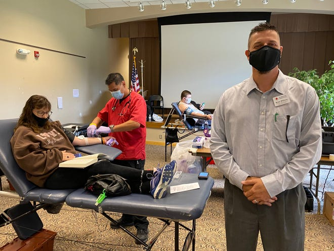 American Red Cross Account Representative Brian Williams, right, at a blood drive in Cambridge. Williams said that January, even pre-pandemic and even more so during the pandemic, is a rough month for the agency for blood collection.