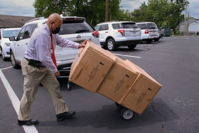 MCPS Director of Pupil Services Karl Lang delivers backpacks donated by Costco to the school district's central office in Columbia for sorting and distribution to schools on Sept. 9, 2020.