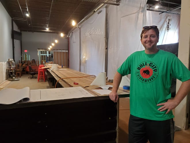 John Clowney, CEO of Bull City Ciderworks, stands at the new bar area being built at the Lexington Depot District business. Bull City Ciderworks is completely overhauling its building space, including the taproom, production room and adding a massive amount of outdoor covered and uncovered seating.