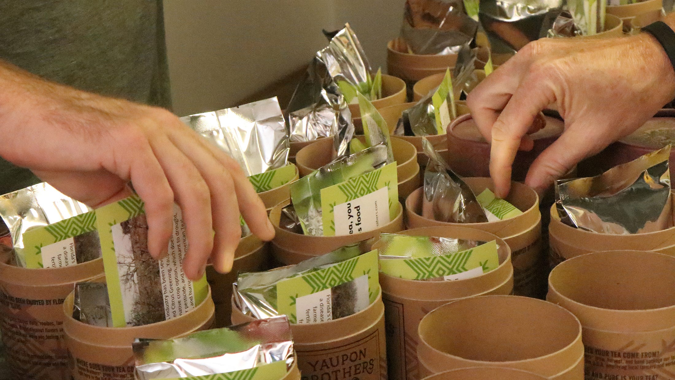 Yaupon Brothers American Tea Company staff fill containers with their tea in Edgewater on Tuesday, Sept. 29, 2020. Since the COVID-19 pandemic, a large portion of the company's sales are online.