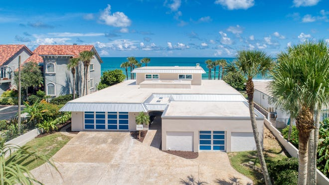 This extensively remodeled oceanfront estate is situated on a highly desirable stretch of beach, along with other million-dollar residences.