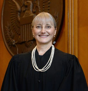 U.S. District Judge Susan Paradise Baxter is hearing a case over a political sign in Oil City that uses an expletive to criticize President Donald Trump. The case is in U.S. District Court in Erie.