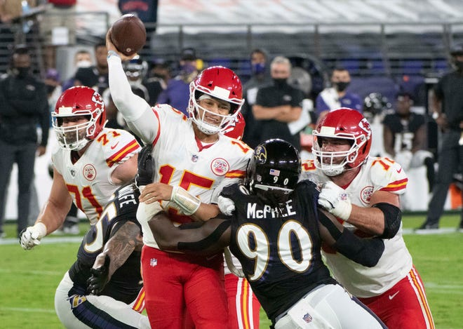 Kansas City Chiefs quarterback Patrick Mahomes (15) gets a throw off as Baltimore Ravens linebacker Pernell McPhee (90) hits him in the first half of Monday night's game at Baltimore. Mahomes threw for 385 yards and four touchdowns and ran for another score to lead the Chiefs to a 34-20 win.