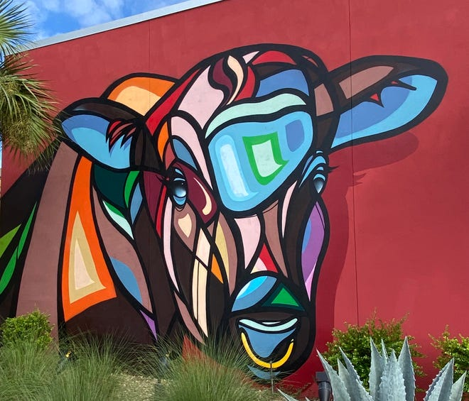 This colorful cow graces the outer wall of ABBQ, 461 Atlantic Blvd.
