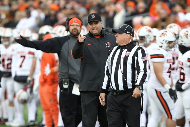 Massillon coach Nate Moore makes a point to an official during the 2019 game at McKinley.