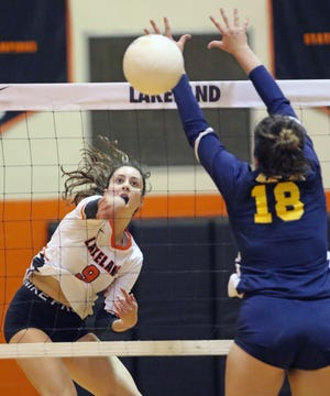 Lakeland's Grace Garcia puts down a kill against Winter Haven during volleyball action last year. Garcia has been one of the Dreadnaughts' key players in their turnaround from 6-13 last year to 9-3 this season.