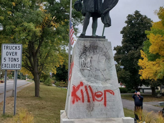 "Images show red paint marking the words ""killer"" on multiple sides of the base of a Christopher Columbus statue Tuesday, Sept. 29, 2020, in Utica. The statue was defaced in a similar manner on Wednesday, Oct. 7, 2020, according to city officials."