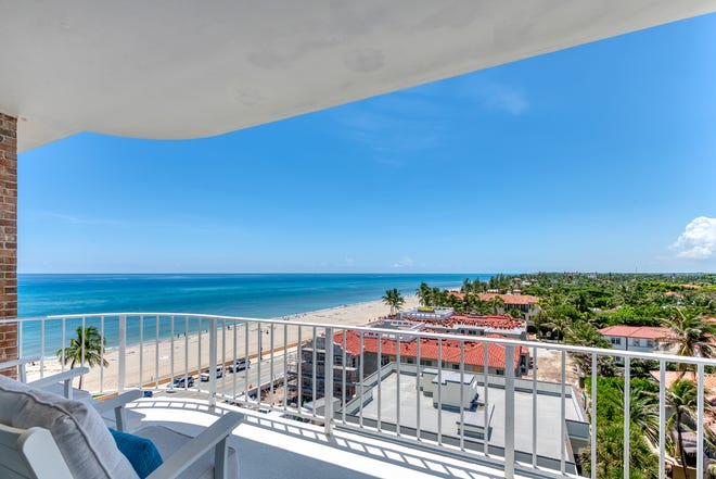 A balcony at Penthouse 17 on the eighth floor of the Winthrop House in Palm Beach looks captures ocean views straight down the coast. [Edouard Zak Photography, photo courtesy Sotheby's International Realty]