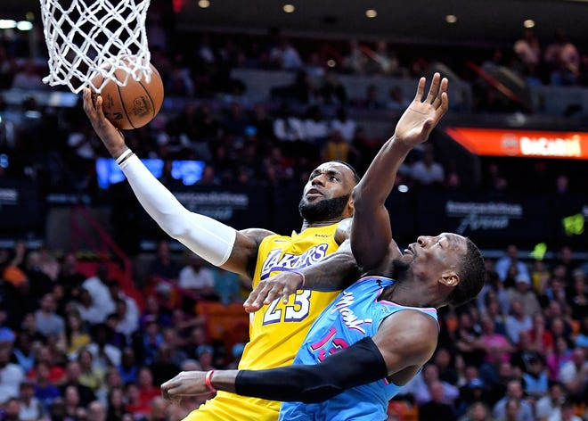 Los Angeles Lakers forward LeBron James (23) drives to the basket against Miami Heat center Bam Adebayo (13) during a game in December at AmericanAirlines Arena.