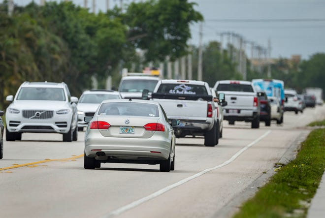 Traffic heading northbound, right, on Lyons Road south of Atlantic Avenue in Delray Beach, Florida, March 18, 2019. [GREG LOVETT/palmbeachpost.com]