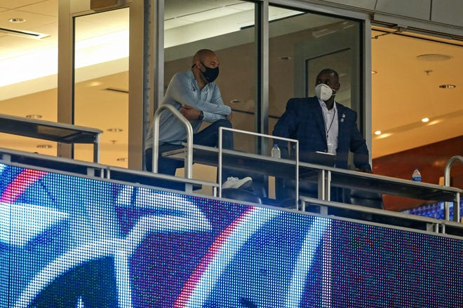 Marlins CEO Derek Jeter (left) and president of baseball operations Michael Hill watch from a suite when the Marlins hosted the Braves last month.