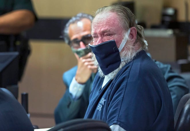 Carlton Nebergall cries Tuesday during his sentencing in West Palm Beach. The former Palm Beach Sheriff's deputy, 64, was sentenced to 13 years in prison for killing his estranged son-in-law in 2018.